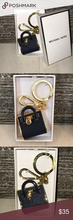 NWT ! MICHAEL KORS KEY CHARM OR BAG JEWELRY!! NWT !!! Beautiful MK purse key charm. Can also be used as a BAG CHARM , by using the lobster clasp and removing the key ring !!! 2 for 1 !!!  Bag charm and key ring !!  COLOR: NAVY BLUE with GOLD hardware ! Michael Kors Accessories Key & Card Holders