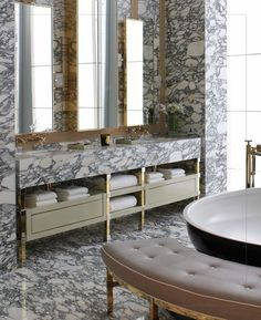 nice vanity set up- marble apron, brass legs, open shelves and drawers