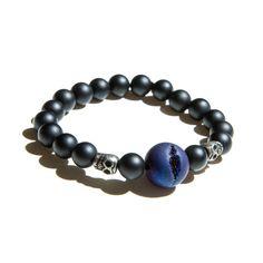 Azul. The Drusy crystal makes this bracelet so amazing. Two mini tibetan skulls.