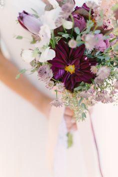 mixed purple bouquet // photo by Mint Photography, flowers by @STEMS http://ruffledblog.com/antique-modern-wedding-ideas #flowers #bouquet
