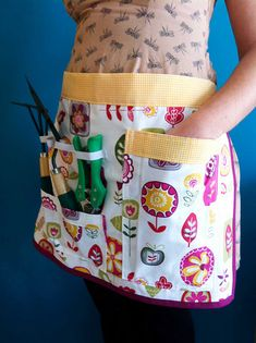 I can see this gardening apron made up in an oilcloth type of fabric.