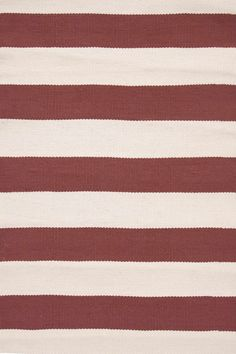 Bold red stripes for indoors or out! (Catamaran Stripe Indoor/Outdoor Rug in Breton Red/Ivory by Dash & Albert)