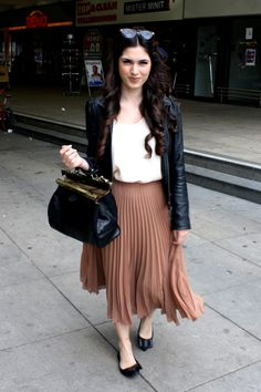My go to outfit.      Pleated skirt + leather jacket - pretty.