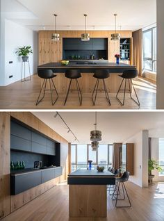 This modern kitchen has black cabinets and countertops that contrast the wood, while brass accents add a touch of glamour. #ModernKitchen #BlackAndWood #KitchenDesign