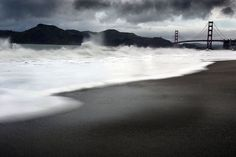 The morning rains stirred up the ocean at Bakers Beach as heavy dark rain clouds moved in over the hills of Marin and the Golden Gate Bridge. 4/7/05