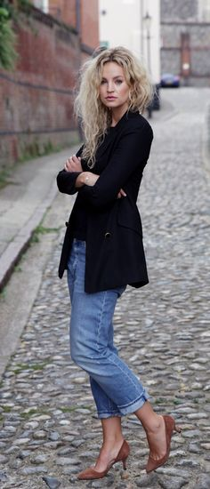 Anouk Yve is wearing a black blazer from Nicole Farhi, boat neck top from Zara, jeans from Acne Studios and the shoes are from Ganni