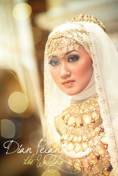 Grand, luxe, breathtaking. Famous Indonesian designer Dian Pelangi in her wedding gown. {Fashion Fighting Famine}