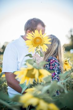 Rewind! I'm blogging all of my favorite past sessions in honor of the new season. Here's #1, Kristen and John's engagement session in a massive sunflower field off the Jerretsville Pike.
