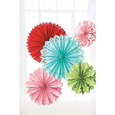 Make a paper fan, cut notches or strategic hole in it, trim the edges, then pull it open. Attach 2, 3, or 4 together to make a full circle.