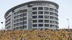 Amazing... Iowa Hawkeyes and fans wave to the sick children in the Children's Hospital, sweet story by Disney.