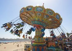 Santa Cruz Beach Boardwalk: Operating since the only remaining oceanfront amusement park on the West Coast has two rides officially recognized as National Historic Landmarks: the hand-carved Looff carousel and the wood-framed Giant Dipper roller coaster Long Beach Boardwalk, Boardwalk Theme, Santa Cruz Boardwalk, Santa Cruz Camping, Santa Cruz Beach, Camping Lights, Coney Island, Venice Beach, Surfing