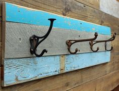 Beach style Driftwood and rusty metal coat hook rail by Reclaimed Time