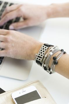 silver arm party with the Fitbit Flex
