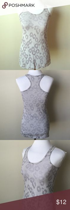 🔴2/$12 3/$17 ExpressAnimalPrintSheerGrayRacerBack Fabulous animal print sheer light gray racer back tank top! This tank top is fabulous and can be worn so many ways. It has been loved very much 💕.  There is pilling of the material as shown in last pic.  52% cotton 48% polyester Express Tops Tank Tops