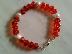 Bracciale con perle e cristalli rossi