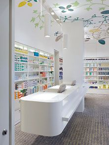 Front counter where the register would be but not a fan of the ceiling design I would want something different Hospital Pharmacy, Pharmacy Store, Pharmacy Humor, Design Exterior, Shop Interior Design, Medical Office Design, Hospital Design, Counter Design, Cosmetic Shop