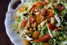 Lime & Peanut Coleslaw - This feather-light, mayo-free, coleslaw recipe uses toasted peanuts, cherry tomatoes, and lime vinaigrette Peanut Coleslaw Recipe, Tangy Coleslaw Recipe, Coleslaw Recipes, Coleslaw Salad, Veggie Recipes, Salad Recipes, Healthy Recipes, Healthy Foods, Vino Y Chocolate