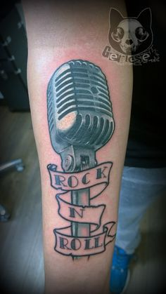 Realistic, colorful microphone tattoo