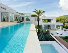 3 Secrets of Applying Best Spanish Home Decoration: Modern Spanish Architecture Glass Home Design With Blue Pool ~ creatvow.com Architecture Inspiration