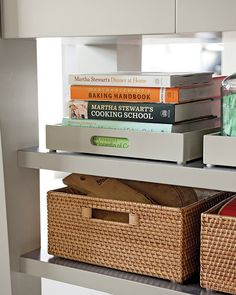 Corral items on open shelves using nice-looking containers. These baskets add warmth and texture to the room; the gray trays are simple and stylish. Add adhesive pads on the bottom so they slide smoothly.