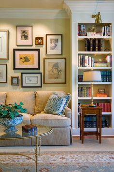 Hanging picture frame collage living room traditional with wood side table glass coffee table white bookshelf