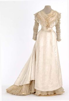Cream brocade satin dress trimmed with silk mull. Made by dressmaker, Mrs. George F. Hall, St. Paul, Minnesota.