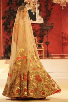 Suneet Varma. A beautiful gold a red rose number. We love the full skirt and net texture as well.