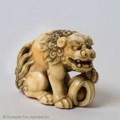 Netsuke of a shishi with tama ball. By Yamaguchi Okatomo, Kyoto school, late century. Ivory with eyes inlaid in dark horn. Art Chinois, Fu Dog, Art Asiatique, Art Japonais, Japanese Characters, Museum Collection, Fantastic Beasts, British Museum, Asian Art