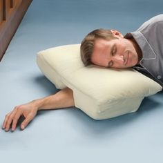 pillow which is ergonomically suited for some people that sleep in that certain position -- a hole for you to place your arm through