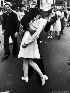 Famous photo: The pair were recreating this famous picture of a couple kissing on VJ Day