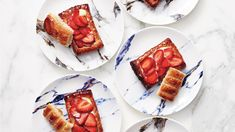 Yogurt puts a new spin on French pastry cream, which is typically made with milk. Much to our delight, the result is brighter in flavor and still delivers that same silky richness. Layer it into a flaky, buttery shell, and then top it with strawberries. Yogurt Recipes, Strawberry Recipes, Tart Recipes, Fruit Recipes, Strawberry Tarts, Pastry Recipes, Strawberry Shortcake, Party Desserts, Dessert Recipes