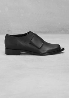 Crafted from smooth leather, these loafers have a raw edge design and a prominent welt that forms a sharp point in the front. - Wide, leather panel across the vamp- Small, triangular metal embellishment fixed to the front of the toe- Cushioned leather insole and leather outsole with rubber beneath the heel- Heel height: 3 cm