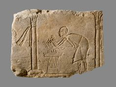 Relief with palace attendant tending burning coals. Amarna (Akhet-Aten), 18th Dynasty