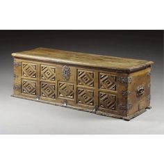 A LARGE BOARDED CHEST, SPANISH,LATE 17THCENTURY carved walnut, with steel mounts and iron carrying handles