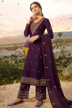 This Purple Satin georgette Trouser Suit which will surely grabs everyone attention. Teamed up with Satin Georgette Trouser in Purple Color with matching Georgette Dupatta. Trouser has Resham, Zari and Stone work. Dupatta perfectly formed using Resham, Zari and Stone Work.