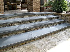 Custom built patio steps with stack stone