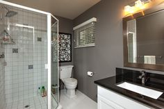 Traditional 3/4 Bathroom with Framed Shower Doors and Framed Shower Enclosures By Dulles Glass and Mirror, Soapstone counters