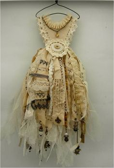 I love this little fairy dress made of old small pieces of lace and charms... so cute!