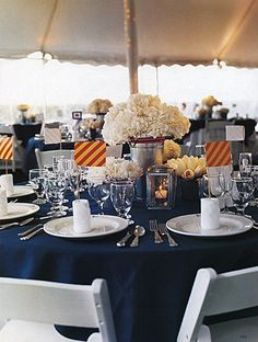 Nautical Wedding/Party Table Decor: Flags in the Napkins so you can identify your table. Goes with name flags at the entrance to the reception.