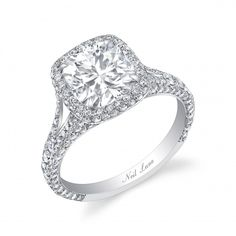 Neil Lane...huge center cushion cut stone, halo, split shank, cathedral setting. Want want want.