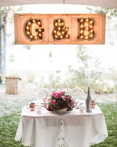 Vintage marquee light with the couple's initials hung over the sweetheart table {Jacquelynn Brynn Photography}