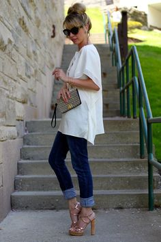 cuffed dark wash jeans with a flow-y top. The shoes make the outfit, but i don't have any like this!