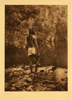 "Apache, 1906.  Photogravure.  Curtis Caption: ""This picture might be titled ""Life Primeval."" It is the Apache as we would mentally picture him in the time of the Stone Age. It was made at a spot on Black river, Arizona, where the dark, still pool breaks into the laugh of a rapids."""