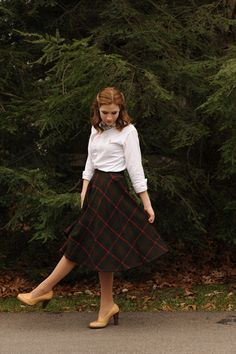 Plaid skirt with a loose fitting button down.