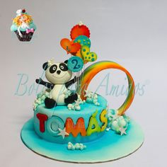 Birthday cake decorated with sugar paste painted using aerograph. Panda hand molded with sugar paste. Rainbow molded with pastillage.