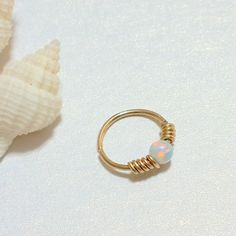 White Opal tragus hoop, tiny tragus ring, tragus hoop earring, tragus piercing jewelry, gold filled tragus opal by HelenCollectionJewel on Etsy https://www.etsy.com/listing/247944103/white-opal-tragus-hoop-tiny-tragus-ring