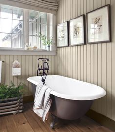 Make old look new again by reglazing an old clawfoot tub and using an old vintage mailbox as a bath cubby -- smart!