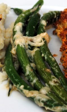 Jamie Oliver's Best Ever Green Beans ■1 1/4 pounds of green beans  ■pinch of Kosher salt  ■3 cloves garlic, sliced  ■1 1/2 cups Parmesan cheese, finely grated  ■extra virgin olive oil  ■1/2 of a lemon