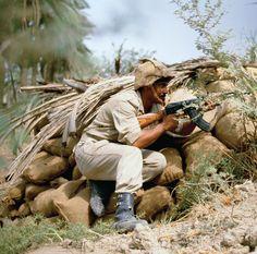 soldier carrying AK-47 during Iran-Iraq War