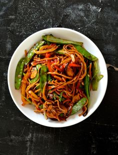 This vegetable lo mein isn't so much a takeout dish makeover so much as just a really simple, versatile noodle dish that can be a staple vegetarian meal or a go-to meatless Monday dinner. It's healthy, tasty, and very easy to make. In China, fresh eggless hand-pulled noodles are readily available (understatement), so that's what we used, but you can feel free to use packaged fresh white noodles or the lo mein egg noodles from the Asian grocery store. You can even sub in dried spaghetti if you have nothing else!